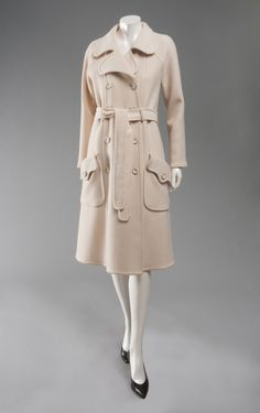 Woman's coat | Designer: Emanuel Ungaro, born 1933 | France, circa 1970 | Material: off-white wool melton cloth | Emanuel Ungaro trained as a tailor and worked as a designer for Cristóbal Balenciaga and André Courrèges before opening his couture house in 1965. The young designer soon became known for his avant-garde approach to designing for the modern woman | Philadelphia Museum of Art