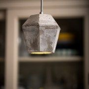 Concrete pendant lampshade with geometric crystal shaped design. The lampshade provides a soft beam of light, using lamp (LED lamp included) and with adjustable height.