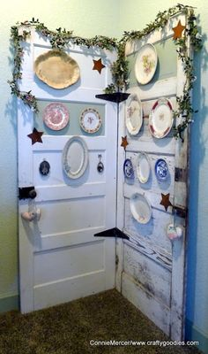 Maybe use several doors that are hinged together for hanging your finished vinyl wall art?!