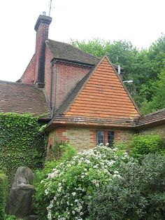 """Millmead sandstone summerhouse (1904-07) - E. L. Lutyens. Sarah Rutherford in The Arts and Crafts Garden: """"open to the front and sides, with wooden columns at the corners supporting a pyramidal tiled roof."""""""