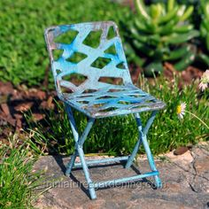 Shades of blue tones, resembling waves washing up on the beach, gently accent this miniature garden Oceanside Chair. In addition, cut out designs create abstract openings in the back and on the seat of the metal chair. The design elements and principles of the chair coordinate well with a beach theme miniature garden. Since it may be sunny at the beach, some of the wee folk will add the Oceanside Umbrella (sold separately) to provide shade for anyone sitting in the chair. Popular with…