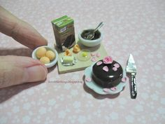 1:12 dollhouse scale chocolate cake preparation board, with rose petal toppings. Handmade by me using air dry clay.