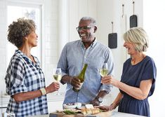 Senior friends enjoying wine and cheese in the kitchen and socializing together at a dinner party Barefoot Wine, People Png, Middle Aged Man, Model Release, Us Images, Men Casual, The Unit, Cheese, Stock Photos
