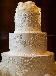 Gold Lace Wedding Cake ~ Very articulate lacework on this wedding cake is so pretty.  I love the buttons on the top tier.  Beautiful cake.   ᘡղbᘠ #laceweddingcakes #weddingcakes