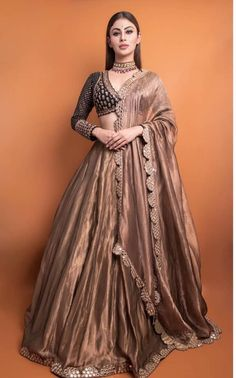Diva Charm : Mouni Roy makes a ravishing statement in a black-copper embroidered lehenga from Vvani by Vani Vats . WhatsApp us now for personal shopping experience! Party Wear Indian Dresses, Party Wear Lehenga, Indian Gowns Dresses, Indian Bridal Outfits, Dress Indian Style, Indian Fashion Dresses, Indian Designer Outfits, Indian Wear, Pakistani Outfits
