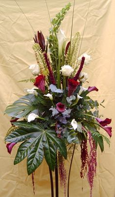 Absolutely LOVE this arrangement. Wouldn't change a thing! Contains white roses, amaranthus, calla lilies, molucella and unusual foliage. Tropical Floral Arrangements, Church Flower Arrangements, Funeral Arrangements, Church Flowers, Funeral Flowers, Purple Bouquets, Bridesmaid Bouquets, Pink Bouquet, Brooch Bouquets