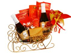 Korbel Sleigh Bell Ride Gift Basket. Sparkle up the holiday with the golden sled filled with Korbel Champagne and Chocolates. Includes two Korbel 187ml bottles, Godiva 2-piece Chocolate box, Lindt Chocolate Truffles, Guylian Belgium Chocolates, World's Finest Meltaway Chocolates, Chewy Caramels, Fruit Candies and Chocolate Truffles. No Minimums. Chocolate World, Chocolate Box, Holiday Gift Baskets, Holiday Gifts, Korbel Champagne, Lindt Chocolate Truffles, Holidays And Events, Caramels