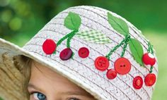 A straw hat with cherry red spots and green cloth embroidered