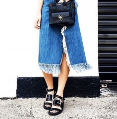 Carmen Hamilton paires her fringe denim skirt with a square tote and Givenchy buckle sandals