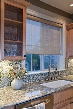Love this solar shade in the kitchen window. Check out our version here - http://blnds.cm/12Bt0AM