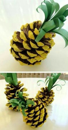 several pineapple ornaments made from a pinecone, painted in yellow, decorated with green paper leaves
