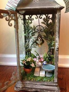 Fairy garden inside lantern.