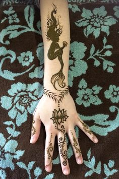 "Mermaid henna by ""Z"" Face & Body Art"