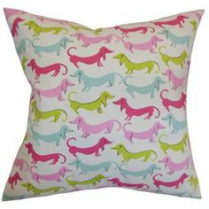 "Down-filled cotton pillow with a multicolor dog motif. Made in the USA.    Product: PillowConstruction Material: Cotton cover and down fillColor: BubblegumFeatures:  Insert includedZipper closureMade in the USA Dimensions: 18"" x 18""Cleaning and Care: Spot clean"