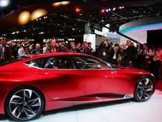 The international media rush to surround the Acura Precision concept luxury sedan after it is revealed during the 2016 North American International Auto Show held at Cobo Center in downtown Detroit on Tuesday, Jan. 12, 2016. The interior features rear seats that look more like lounge chairs.