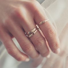 """""""A stack of golden Arrow bands and our Slim Lovers Knot ring in 14k, regram @bluboho. #OdetteNY"""""""