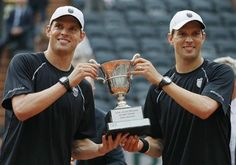 Bryan and Bryan of the U.S. pose with their trophy after defeating Llodra and Mahut of France in their men's doubles final match to win the French Open tennis tournament in Paris