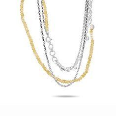 This stunning double chain necklace is made with bright faceted citrine beads and sterling silver. Delicate little silver details in the chain move and catch the light in a most beautiful way. Perfect for a beautiful layered look
