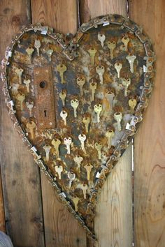 Heart decoration from scrap metal collage with keys
