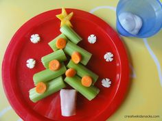 Veggie Christmas Tree!!!! Use cut celery arrange shape of the tree. Slice a baby carrot into wheels for the ornaments. Cut a yellow pepper into the shape of a star. Create the trunk by rolling a slice of deli ham #Cute #Healthy