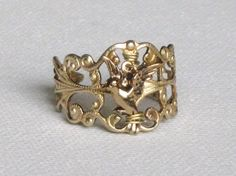 The Hunger Games Mockingjay ring in Gold by TheGreenForrest, $14.00