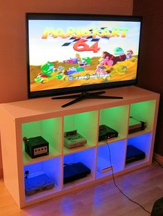 Custom video game system console shelves - modified Ikea cabinet with LED lights via Reddit user Calvoz0r