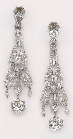 A pair of Art Deco platinum and diamond ear pendants, 1920-30. #ArtDeco #earrings