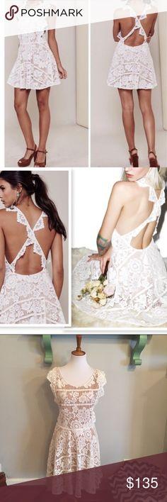 "•nwt• for love and lemons Gianna apron dress NWT white Gianna apron dress by for love and lemons. Cross back style. Lace dress, fully lined. Back zipper at skirt. Bust 17"". Waist 15.5"". Length 36.5"" For Love And Lemons Dresses Mini"