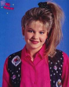 What makes this the most epic ponytail of the '90s? Well, we have a lot of early '90s trends going on at once. First off, there's the side ponytail, secondly, it's held together by a scrunchie (polka dot, no less), third, she has teased out bangs, and fourth, and most importantly, she has frosted hair. FROSTED HAIR. | Ranking The 13 Most Important Celeb Ponytails Of The '90s