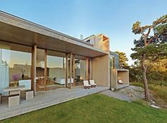 The facade of the three-bedroom house sports a series of extruded pine  boxes c121bb2b31e