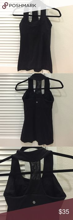 Black lululemon running top with built in bra Black lululemon running top with built in bra; decent support for a-b cup; medium support for c+ cup; worn only a handful of times; mesh back t-back panel; fairly new condition lululemon athletica Tops