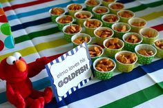 {cute}  Any kid or parent who watches much Sesame Street these days knows the theme song to the Elmo's World segment very well.  I made a play on that and Elmo's pet goldfish by serving goldfish crackers in cute little party cups.  This ever-popular kiddo snack was a huge hit and kids kept grabbing a cup here and there throughout the party.