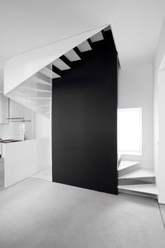 White metal staircase + Black wall