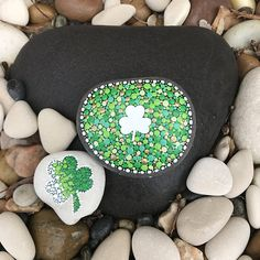 I love Rocks!! I especially love dotty lucky rocks. This is a set of 2 painted Shamrocks. I painted the rocks with acrylic paint and sealed it with indoor mod podge. The large dotty white Shamrock is @ 3.5 x 2.75 inches. It has 2 small white dots on the unpainted part of the rock, so I