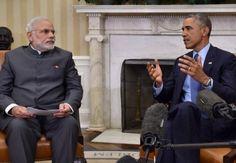Narendra Modi looks on as President Barack Obama