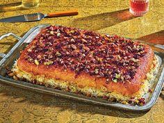 This crispy Iranian casserole—buttered saffron rice with yogurt and lemon chicken—is an easy, impressive main course. Persian Chicken, Persian Rice, Saffron Chicken, Lemon Chicken, Raw Pistachios, Tapas, Arroz Frito, Saffron Rice, Gastronomia