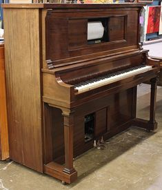 PIANO! Wurlitzer upright player piano.  We had a library full of player rolls and my mom would sing and play while she was waiting for the washing machine to move to the next cycle,  JBO