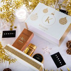 Precious, shiny and full of surprises, like your Christmas: Kérastase Coffret Coup de Coeur is the #magical gift set that contains 1 Elixir Ultime Oil (100 ml) and 2 travel sizes of Elixir Ultime Bain and soin, for a guaranteed success with your best friends under the XMas tree!  Buy now the Coffret Coup de Coeur and make a present!  #Gift #Hair #xmas2016 #Precious #Gold