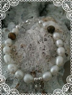 baby bracelet https://www.facebook.com/parelsenstrikjes  De dochter armband uit de serie TO Armband Anne   Babyarmband: €16.95  Kinderarmband : €18.95  Gemaakt van de tijgeroog kraal gecombineerd met sterling zilver en zoetwaterparels