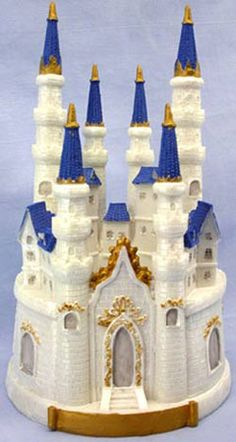 """Enchanting Castle Cake Topper or Centerpiece measures 9 1/2"""" tall x 5 1/2"""" in diameter and is made of durable poly-resin."""