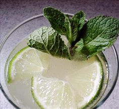 ** Champagne Mojito ** - 3 ounces champagne, chilled - 4 mint sprigs - 3 teaspoons sugar - 2 tablespoons lime juice - 1 lime wedge