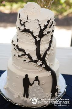 Black and white cake with a silhouette of the couple and a tree with small white blossoms. This looks like lace. It would be lovely with your dress. Funny Wedding Cakes, Wedding Cake Photos, White Wedding Cakes, Beautiful Wedding Cakes, Wedding Humor, Wedding Cake Designs, Beautiful Cakes, Silhouette Wedding Cake, Silhouette Cake