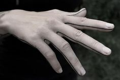 Minimalist hand tattoo. Finger tattoo
