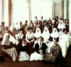 Alexandra and OTMAA surrounded by wounded soldiers and nurses in their hospital during WWI