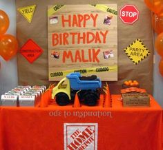 """I hand painted the Happy Birthday sign and added the """"caution"""" tape as a last minute touch. Suzan included photos of Malik from when he was a newborn up until his third birthday."""