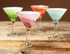 Give your dinner table a festive touch with colorful glassware Galaxy martini glasses are sold as a set of four (4) Barware is hand-blown and spun to create swirl patterns so unique that no two are id