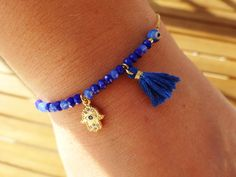 Hey, I found this really awesome Etsy listing at https://www.etsy.com/listing/469629962/blue-gold-hamsa-charm-bracelet-gold