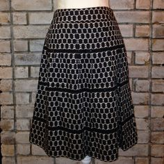 Stunning Black and Beige Skirt Gently loved cotton skirt. Has sequence detail. In great condition. Measures 23 inches long and 14 inches across the waist. LOFT Skirts A-Line or Full
