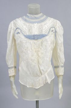 Woman's blouse United States, early 20th century | White cotton with embroidery, lace, sheer blue linen | Philadelphia Museum of Art