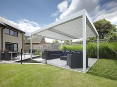 large umbris patio roof using vertical automated louvre as